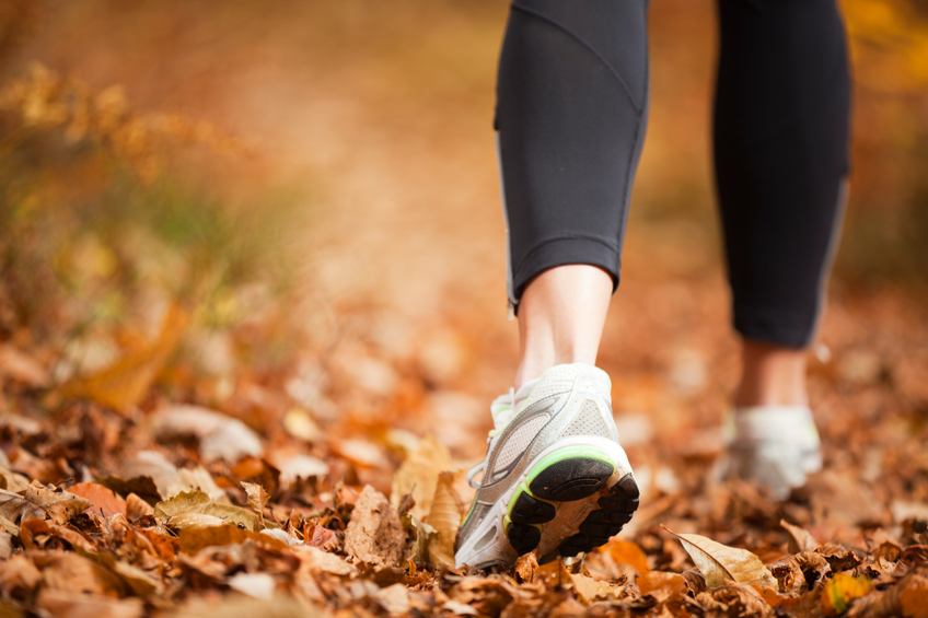 closeup of a women's running shoe treads on a autumn forest footpathCHECK OTHER SIMILAR IMAGES IN MY PORTFOLIO....